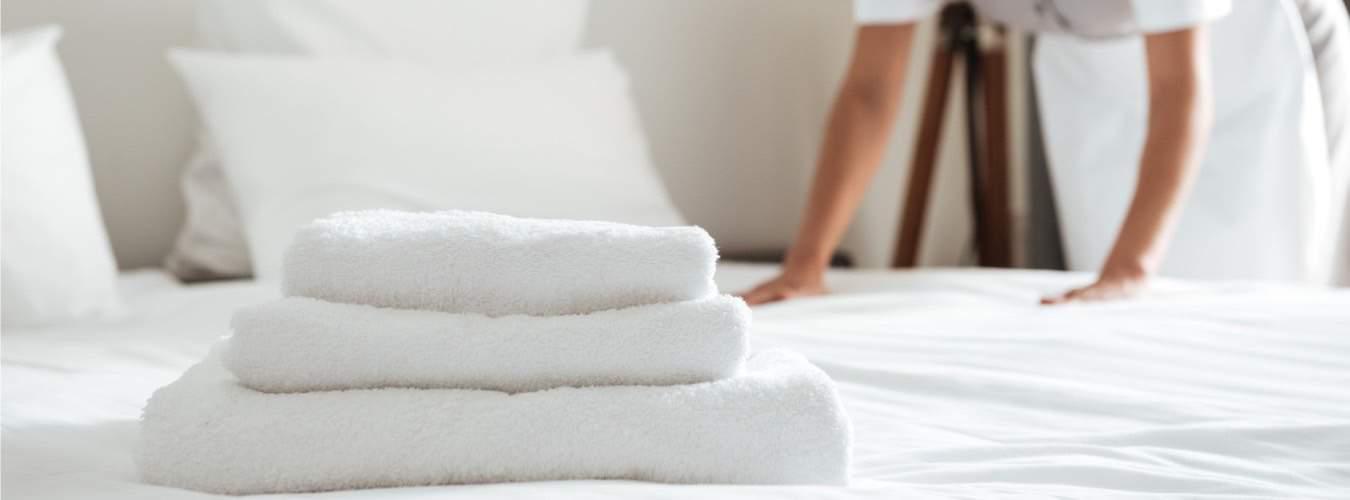 Reiserecht bei Reisemängeln - Handtücher auf Hotelbett